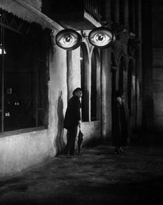 Die Straße (Karl Grune, 1923) - It tells the story of one night in which a middle aged man is lured away from his happy home into the thrills and dangers of the city streets.  In one extraordinary scene the bumbling man passes an optometrist's shop on a crooked, deserted street. The moment his back is turned, an enormous neon sign, a pair of eyeglasses, blinks on. The street itself is alive and watching.