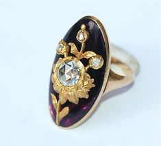 Georgian Sunflower Ring, circa 1780. The tapering gold shank supports an oval dome of cabochon amethyst glass set over cerise-pink foil and inlaid with a foiled rose-cut diamond and gold sunflower, symbolic of love and fidelity. Via Jewelry Nerd