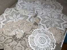 In this listing you will find 8 vintage crochet doilies in cream and tan. Most have stains and would be perfect to dye. You get 1 rectangle, 2