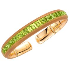 Hemmerle: A Peridot Cuff Bracelet, set with 18 peridots weighing carats, mounted in sandblasted yellow gold, signed Hemmerle, circa Antique Bracelets, Love Bracelets, Cartier Love Bracelet, Cuff Bracelets, Bracelet Set, My Birthstone, Birthstone Jewelry, Peridot Jewelry, Peridot Rings
