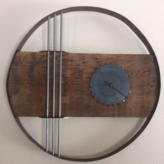 Everyone has a need to know time and in every home you find a time piece keeping that time. But what about making the clock an art piece that uses all reclaimed products. Barrel rings, iron rods, saw blade, barn wood and metal plates for every decor.