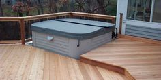 Deck Addition Ideas Consider adding a privacy wall or hot tub to your deck Some people are looking for additional elements to add to their deck. Hot Tub Deck, Privacy Walls, Deck Builders, Custom Decks, Building A Deck, Beach Landscape, Outdoor Furniture, Outdoor Decor, Sunroom