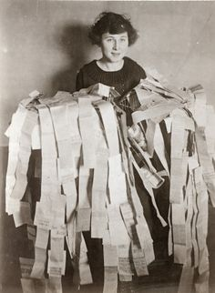 Suffrage worker with one day's worth of news clippings during the 1919 campaign for the woman suffrage amendment. From the ©Missouri History Museum