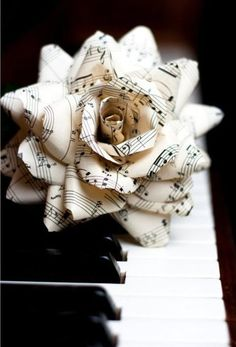 This would be so cool made out of the sheet music from your first dance - would make a great Christmas ornament/keepsake
