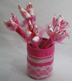 these are pens and a pot covered in fabric for a child this is creative and fun