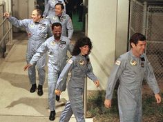 Ronald McNair (third in line) and his fellow Challenger astronauts head to the launch pad at Kennedy Space Center to board the space shuttle on Jan. 27, 1986. Link to a story about his childhood as told by his brother. Nasa Astronauts, Space Shuttle Disasters, Challenger Crew, Christa Mcauliffe, Space Shuttle Challenger, John Wayne Gacy, Star Trek Show, Taxi Driver, Space Shuttle