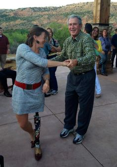 President George W. Bush dances with a wounded warrior at the end of his annual 100-kilometer Warrior mountain bike ride this week in Palo Duro Canyon State Park. This event highlights the bravery and sacrifice of the warriors wounded in the global war on terror, as well as those organizations that have made continuing commitments to supporting America's heroes.