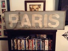 A fun sign to do. The Eiffel tower is very easy to paint, just a triangle and x's.