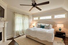 Windows above bed in master bedroom