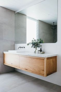Ensuite. solid timber vanity with curved edges on the mirror