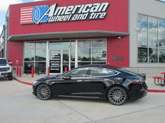 Vossen VFS2 Wheels in Gloss Graphite on a Tesla Model S. 22x9 front with 245/30-22 tires and 22x10.5 rear with 295/25-22 tires.  http://www.americanwheelandtire.com/