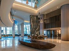 Jumeirah Beach Hotel reopens after major renovation. | UMAYA Lighting Design New Look Inspire, Lobby Reception, Public Space Design, Blue Accents, Beach Hotels, Guest Bedrooms, Contemporary Style, Lighting Design, New Homes