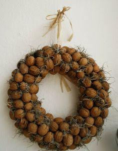 Use you hot glue gun to attach wallnuts to a straw wreath. www.songbirdblog.com