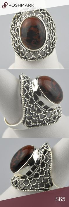 Mahogany Obsidian .925 Sterling Silver Ring 8.75 Mahogany Obsidian is a natural glass obsidian in which the colors stripes are created from iron inclusions. A popular stone in crystal healing thought to remove energy blockages.   Stone measures 27mm x 14mm.   Genuine .925 Sterling silver will tarnish without proper storage & care.  100% natural stone, so inclusions, cracking, veining, etc may be present.   Smoke free pet friendly home.  Internal SKU: MOBSISS01 Jennies Jewels Jewelry Rings