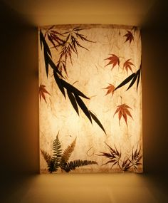 www.AmbientArt.com.  Always beautiful, always ambient, always Art.  Custom lighting, wall sconces with hand made papers and botanical elements.