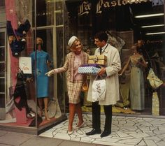 The Melbourne shopping experience 1965 - how things change ..  Pic by Wolfgang Sievers - Couple leaving La Pastorale Frocks - 125 Collins street.