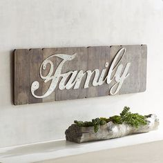 """If you don't already have a gallery wall, here's why you need to start one. By displaying a single word—""""Family""""—you send a special message to all who call your place home. Our rustic plaque's classic font is rendered in galvanized metal and mounted on weathered-look wood, making a big statement over the mantel, in the kitchen or strategically positioned in your entryway."""