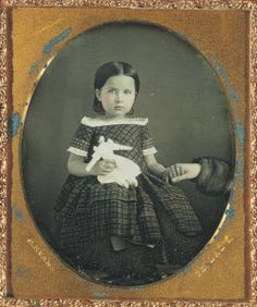George Eastman house Collection, 1840's daguerreotype of little girl holding her hidden mother's hand.