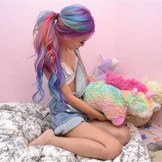 Going to do this for halloween/.Rainbow hair color with curly ponytail, incredible hair look