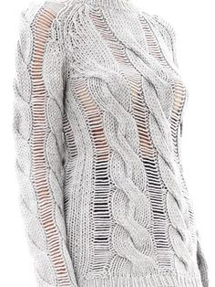 Carven Twisted cable-knit sweater/ This grey twisted cable-knit sweater from Carven is spun from pure wool and feels irresistibly soft against your skin. Layer yours over a nude camisole, balancing the oversized silhouette with a mini skirt or skinny denim.  $554