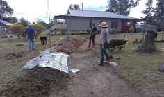 swale being covered over with paper and mulch - quite satisfying!