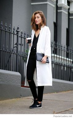 Black pants, tee and white coat