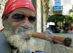 Cuban Cigars | Cuban Jose Manuel Soto, 56, smokes a cigar in the center of Old Havana ...