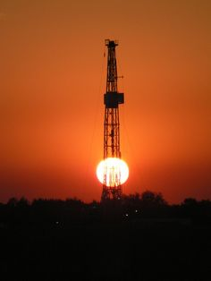 Drill rig with the sun peeking through it.