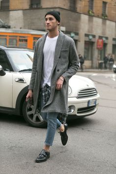 Gray Double Breasted Sweater Coat, Beanie, Worn Fitted Jeans, and Navy Patent Loafers. Men's Fall Winter Street Style Fashion.