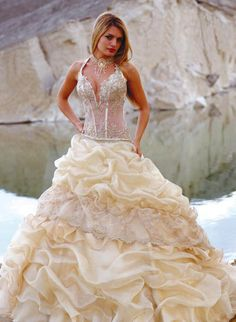 This sexy wedding dress has a large ball gown skirt.  The embellishments on the bodice is on a slightly nude colored fabric with a corset style fit.  We are in the USA and can recreate a wedding gown like this for you at a great price.  We specialize in affordable custom #weddingdresses and inexpensive #replica bridal gowns too.  Contact us for pricing on any dress from the internet to see if we can make for you for less than the original.