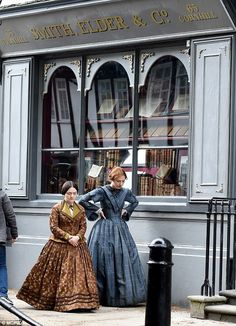 Finn Atkins and Charlie Murphy film a scene for To Walk Invisible as Charlotte and Anne Bronte outside a reconstruction of Smith, Elder & Co - Charlotte Bronte's publisher - in York on 19th May