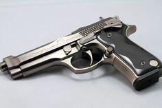 Beretta 92 Billennium (A custom limited edition Beretta handgun to commemorate the new millennium. Only 2000 were made.)