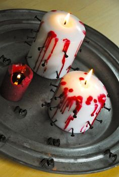 Bloody candles with nails that you might want to have for 2014 Halloween - decoration