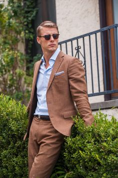 handsome textured brown suit. baby blue candy striped oxford. chocolate belt. chocolate brogues. baby blue pocket square or classic white. shades. clean. comfortable. style.