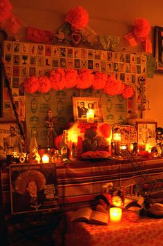 Candlelit altar with loteria cards