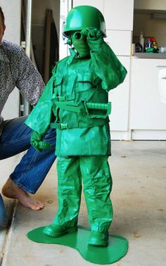 This is amazing!! Green panty hose for face, and everything else could be purchased at goodwill or a thrift shop-including some plastic play weapons and then buy some non-toxic spray paint and spray everything..cut yourself out a platform from some poster board and spray that bay boy too!!  Waa-Laa MAGIC-instant GI Joe!!