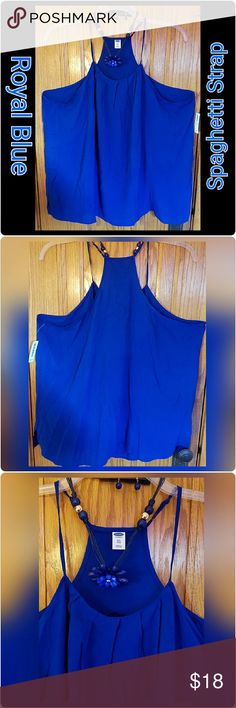 NEWRoyal Blue Spagetti Strap Flowy Tank This is such a pretty blue tank perfect for dressy night out or a work professional. Its flowy and soft with a bit of a silky feeling. Very good to hide any problem areas in tummy my problem lol and looks so sexy with thr scoop neckline. Add a great necklace, black capris and wedge heel and hit the town. Im a 22/24 and it fits me . Old Navy Tops Tees - Long Sleeve
