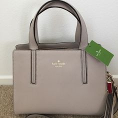 """Kate Spade Dominique Satchel Leather with 14-karat light gold plated hardware Double handles with about 5.5"""" drop; optional adjustable crossbody strap Top zip closure Interior features zip, cellphone and multi-function pockets . dust bag included kate spade Bags Satchels"""