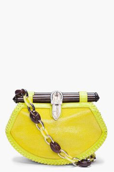 PROENZA SCHOULER   Lime Tiki Clutch    Kinda reminds me of something a nana would have... But cooler. And it has ORANGE SUEDE LINING! *swoon!*