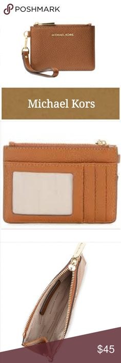 NWT Michael Kors Mercer Coin Purse Carry-everywhere and go with the Mercer Small Coin Purse! A staple accessory that you'll have with you from handbag to handbag, it's an essential for keeping your cards, coins and cash in place.  5.13-in. W x 3.63-in. H x 0.5-in. D  Top zip closure  Exterior: 3 credit card slots, 1 ID window  Removable wristlet strap  Silver-tone hardware; Self-color stitch trim  Clean with a soft cloth.  Leather in luggage  Excellent condition.  Never used.  Smoke free…