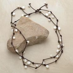 Leather and pearls...simple and beautiful.  I like the idea of being able to wear this as a necklace or as a bracelet.  I could create my own version of this...