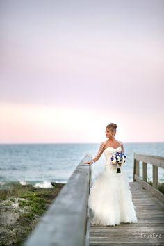 Beach Wedding | True Era Photography #sunset #beach #wedding #bride #bouquet #portrait #twilight #weddingdress #updo #boardwalk #oneocean #weddingphotography #weddingphotographer #jacksonville #jacksonville #florida #bouquet