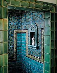 Motawi's 'Tapestry' tiles are used with vivid blues and greens and a three-dimensional niche to create an exotic space.