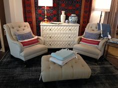 Timothy Paul Home shared this picture of their display with a pair of Gabrielle Chairs from the Alexa Hampton Collection with a Murano Chest from Atelier Collection.