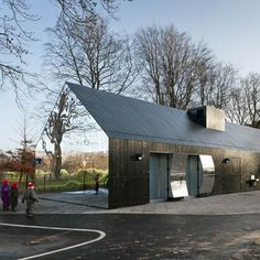 Mirror house in Central Park, Copenhagen by MLRP. The gabled building is clad with mirrors at both ends and houses spaces for children's activities.