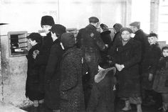 Lodz, Poland, Waiting line for food stamp distribution in the ghetto.
