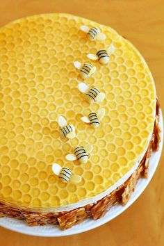 Sponge-cake with sliced honey-toasted almond-squares around the side - decorated on top with eatable bees .... MR ~