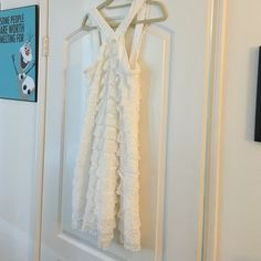 White sundress Super cute ruffle white sun dress. Can be dressed up or dressed down. I wore it to a sorority formal! Ali Ro Dresses Mini