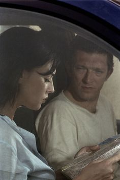 "Monica Belluci reading a map in the film ""Secret Agents"" (with Vincent Cassel)"
