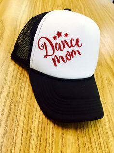 Show your dance mom pride with this trendy & fashionable snap back trucker hat. Dance mom applied with high quality heat transfer vinyl. Black hat with the color of your choice. If you would like a color you dont see listed, please contact me